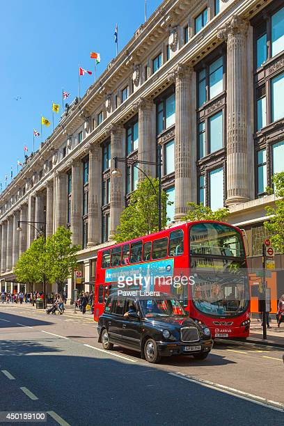 Bus and taxi cab at the front of Selfridges Department Store on Oxford Street in London
