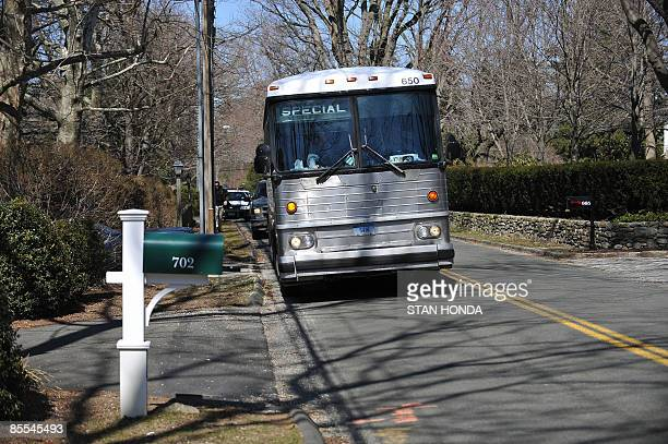 A bus arrives at the home of AIG executive James Haas March 21 2009 in Fairfield Connecticut A bus tour organized by the Connecticut Working Familes...