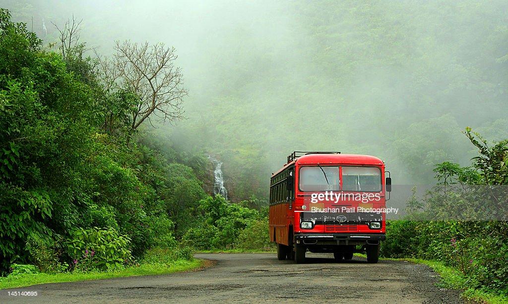 Bus at village : ストックフォト