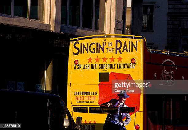 A bus billboard for ''Singin' in the Rain'' December 8 in London England Central London captures the Christmas holiday spirit with shops museums...