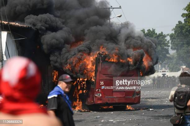 TOPSHOT A bus burns down during a protest in the border city of Urena Tachira after President Nicolas Maduro's government ordered a temporary...