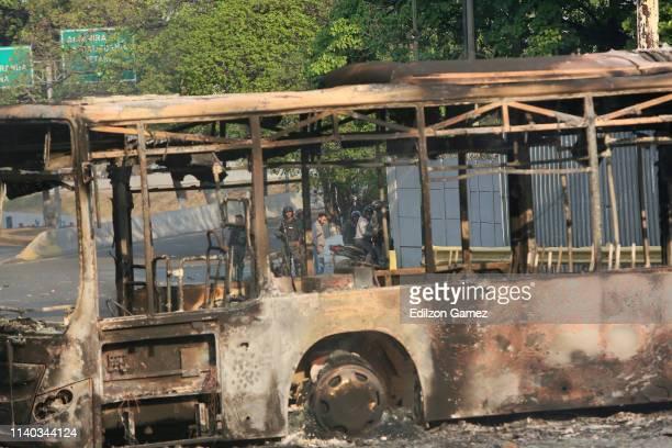 A bus burnt by ProGuaidó demonstrators is seen at Libertador de Chacao Av near La Carlota on April 30 2019 in Caracas Venezuela Through a live...