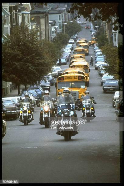 Bus caravan moving through South Boston street w police escort during school integration crisis