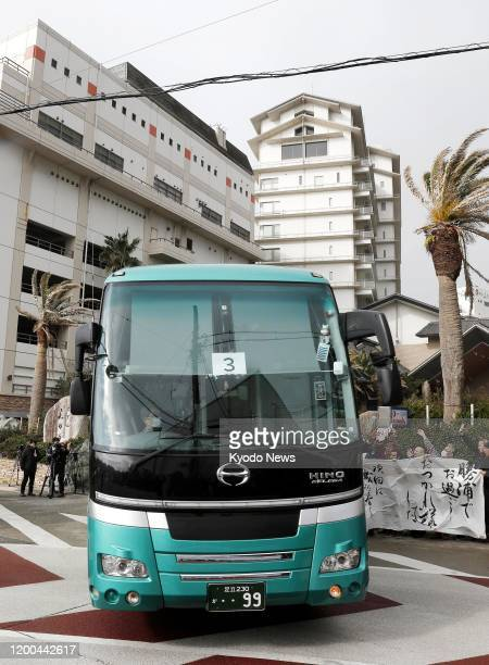 A bus carrying evacuees from Wuhan the epicenter of the new coronavirus outbreak in China leaves a hotel in Katsuura Chiba Prefecture near Tokyo on...
