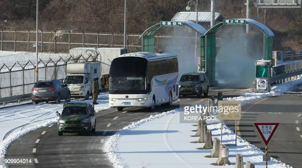 A bus carrying North Korea's women's ice hockey players who will form a unified Korean team at the Pyeongchang Winter Olympics drives past the...