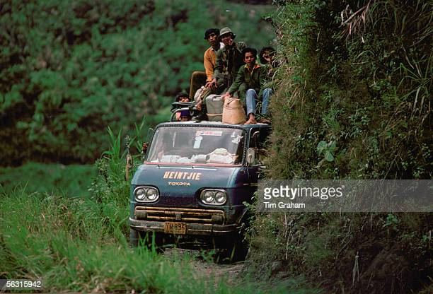 Bus carrying passengers to Banue along a narrow mountain road Philippines