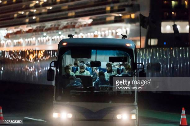 A bus carrying passengers who will board the Qantas aircraft chartered by the Australian government from the quarantined Diamond Princess cruise ship...