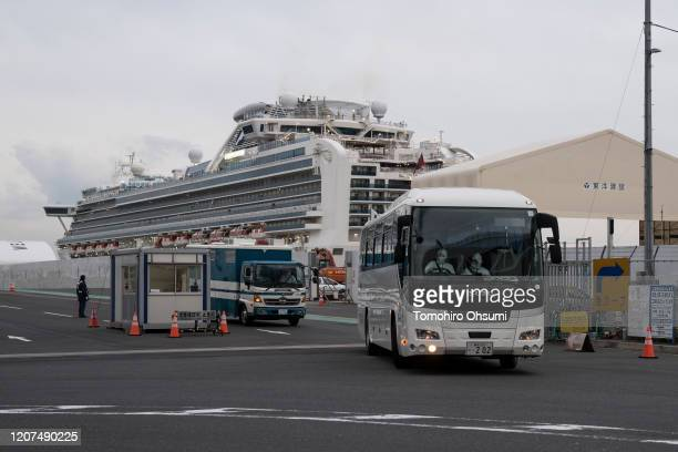 A bus carrying passengers who will take a flight chartered by the Government of Israel from the quarantined Diamond Princess cruise ship drives at...