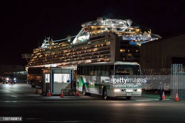 A bus carrying passengers who will take a government charter flight from the quarantined Diamond Princess cruise ship drive at the Daikoku Pier on...