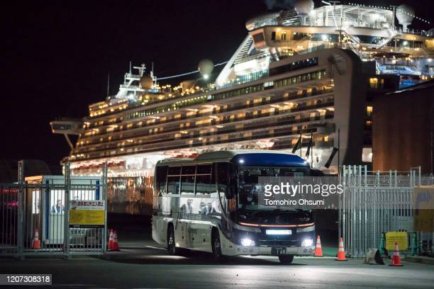 A bus carrying passengers who will take the flight chartered by the government of the Hong Kong Special Administrative Region of the People's...