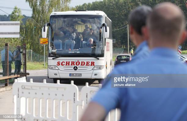 A bus carrying refugees arrives at an accommodation in Gera Germany 21 September 2015 The German state Thuringia has established its eighth refugee...