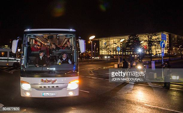A bus carrying refugees with asylum status in Germany leaves the chancellery in Berlin on January 14 after it arrived from the Bavarian city of...