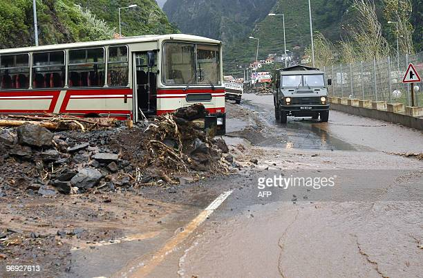 A bus caught by a landslide is pictured near Ribeira Brava Madeira Island on February 21 2010 Violent rainstorms left at least 40 people dead on the...