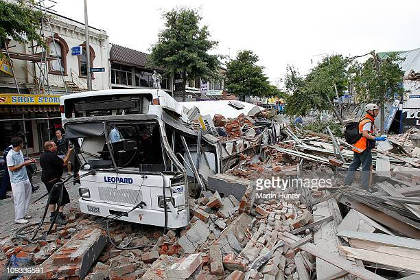 Bus covered in building debris is seen on February 22 2011 in Christchurch New Zealand The 63 magnitude earthquake an aftershock of the 71 magnitude...