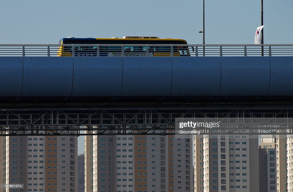 A bus crosses the Handuri bridge in Sejong, South Korea, on Tuesday, Dec. 4, 2012. The construction of Sejong City 120 kilometers (75 miles) south of the capital fulfills the vision of the late President Roh Moo Hyun, who pledged to reduce the dominance of Seoul and pump money into a region courted for its swing voters. Photographer: SeongJoon Cho/Bloomberg via Getty Images
