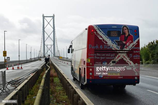 Bus crosses the old Forth Road Bridge as a phased re-opening to some scheduled bus services begins, on October 13, 2017 in South Queensferry,...