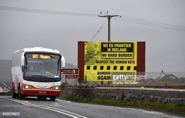 A bus crossing along the border between Northern and southern Ireland passes a sign campaigning against a so called hard Brexit on February 2 2017 in...