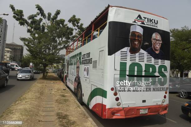 A bus decorated with campaign posters bearing images of the opposition Peoples Democratic Party election candidate Atiku Abubakar and his running...