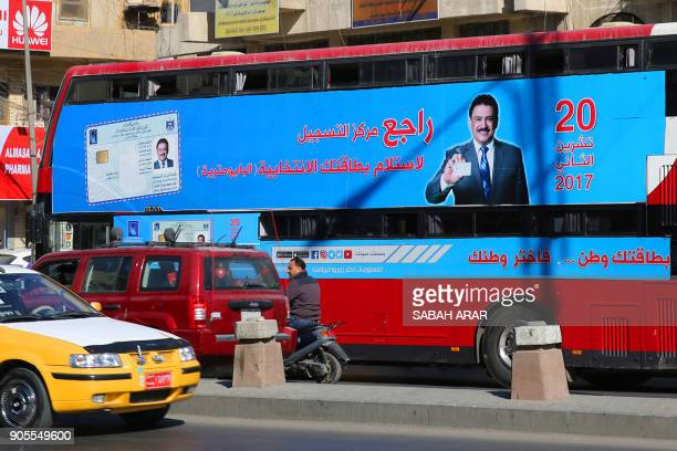 A bus displays a poster advising people to check about their voting information ahead of Iraq's parliamentary elections on January 16 in the capital...