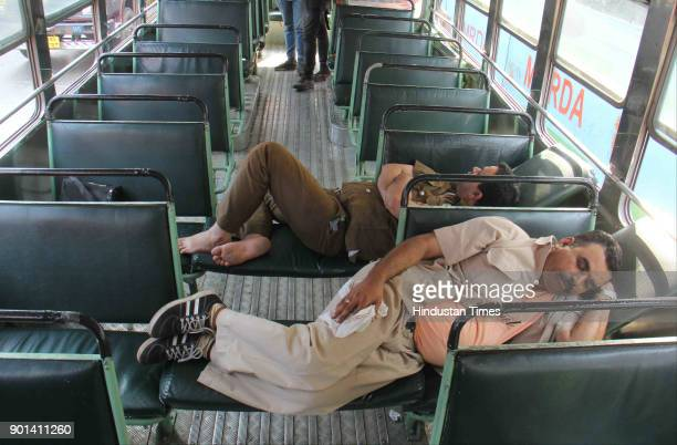 BEST bus driver and Conductor take a nap as Traffic jammed for more than 5 hours due to Rasta Roko by Dalit protesters during Maharashtra Bandh at...