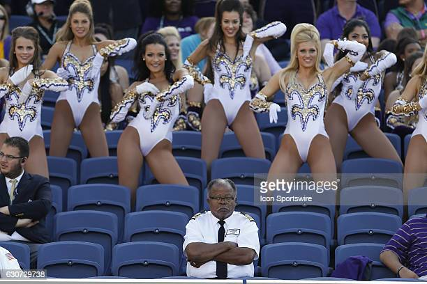 A bus driver for the LSU Tigers watches the game as the Golden Girls dance team dances behind him in the seats during the 2016 Buffalo Wild Wings...