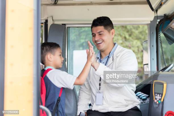 Bus driver gives student high five
