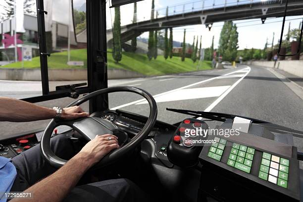 Bus driver going down the road