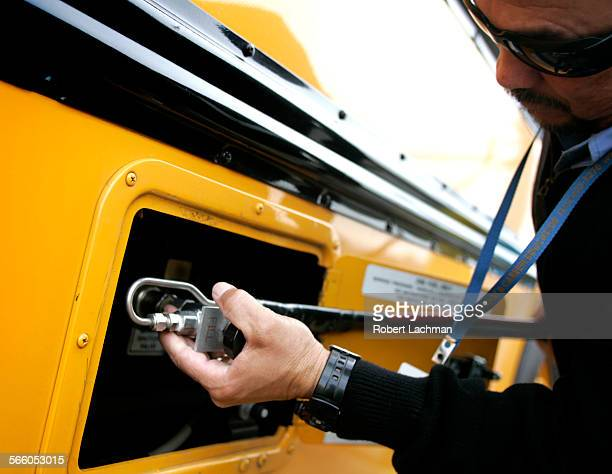 Bus driver Jos Serrano of Long Beach fuels up his CNG fueled school bus at the transportation center in Garden CA on February 23 2010 LAUSD is in the...