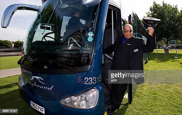 US bus driver Leon Batchelor poses on one of the new Greyhound buses at the launch of the service near Tower Bridge in central London on August 19...
