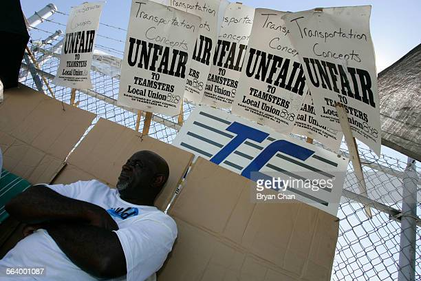 Bus driver Louis Minnefield pickets with Teamsters and MTA bus drivers outside a Transportation Concepts bus storage in City Terrace. They are...