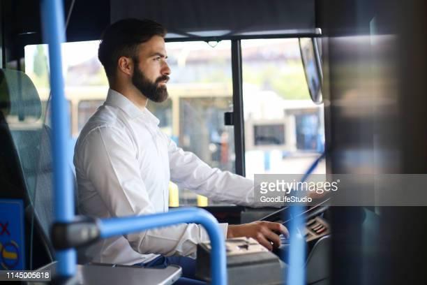 busfahrer - berufsfahrer stock-fotos und bilder