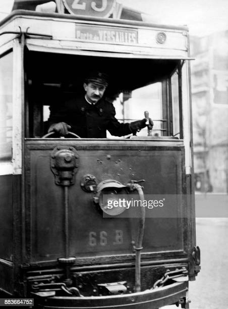 A bus driver rides towards Porte de Versailles in 1926 in Paris / AFP PHOTO /