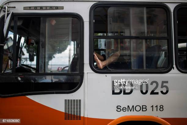 Bus driver sleeps during protest against the social welfare reform at the start of a nationwide strike called by unions opposing austerity reforms on...