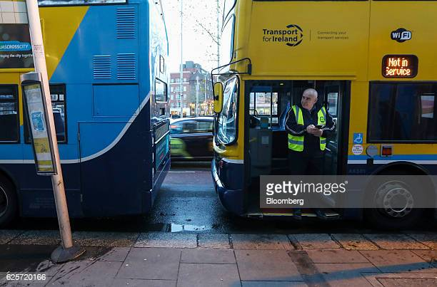 A bus driver stands in the doorway of his bus at a bus stop in Dublin Ireland on Thursday Nov 24 2016 Irish ministers and executives are closely...