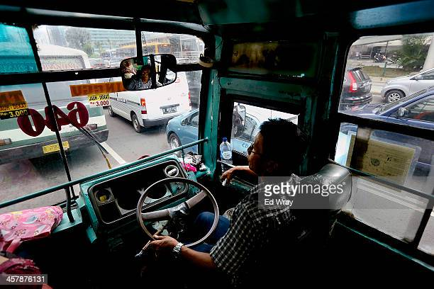 A bus driver stuck in traffic on December 19 2013 in Jakarta Indonesia Transportation experts have been warning that Jakarta could experience total...