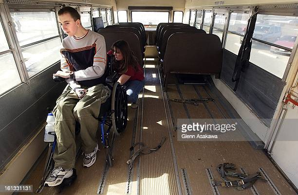 Bus driver Tonya Cole attaches harness to Matt Elmont's wheel chair before shuttling him back to Lakewood High School after spending the morning at...