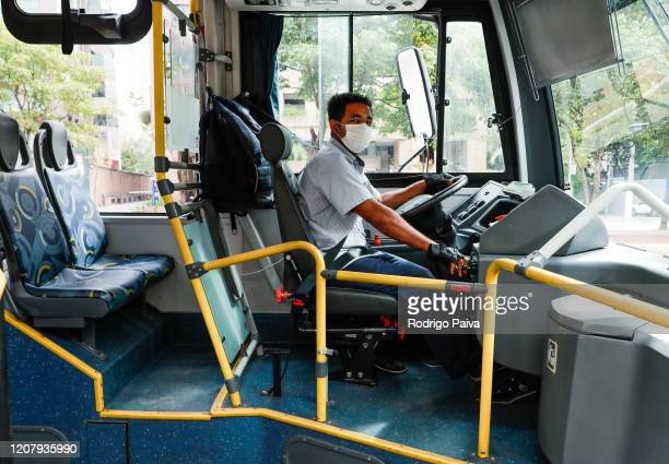 A bus driver wearing a mask at Brigadeiro Faria Lima Avenue during a lockdown aimed at stopping the spread of the coronavirus pandemic on March 21 in...