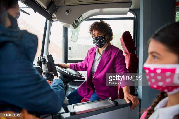 bus driver wearing a protective mask - greeting stock pictures, royalty-free photos & images