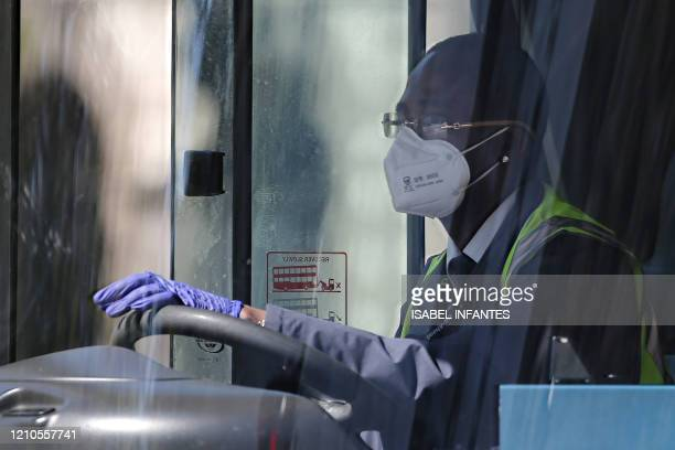 Bus driver wears a facemask as he travels in Westminster, central London on April 21 during the nationwide lockdown to combat the novel coronavirus...
