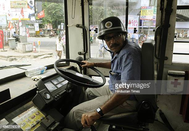 A bus driver wears helmet while driving the bus during a 24hours nationwide strike called by 10 Trade Union Parties against BJP's proposed labour law...