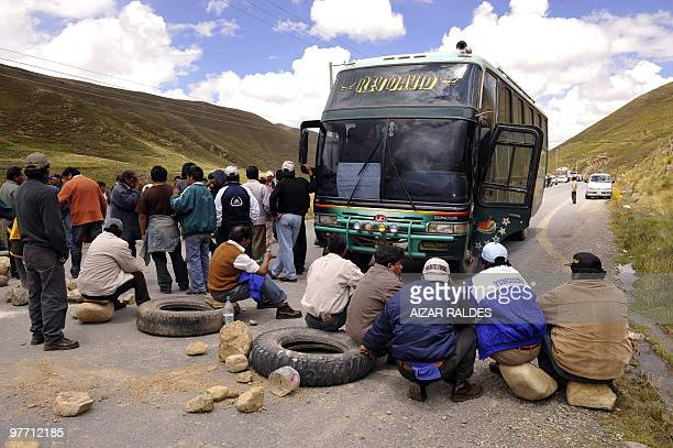 Bus drivers blockade an interprovincial road in the outskirts of La Paz on March 3 2010 Bus drivers reject a Government's decree banning inebriated...