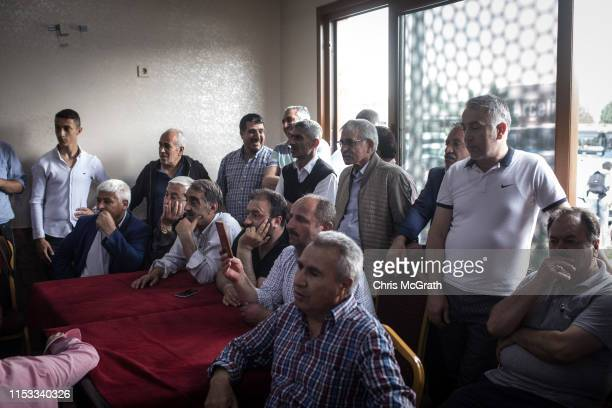 Bus drivers listen to Ekrem Imamoglu CHP Party candidate for mayor of Istanbul speak during campaigning at a public bus depot in the rerun of the...