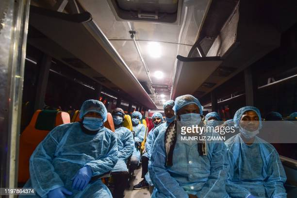 Bus drivers wait to transportBangladeshi nationals evacuated from the Chinese city of Wuhan, following the coronavirus outbreak, to a quarantine...