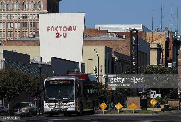 Bus drives by a sign on June 27, 2012 in Stockton, California. Members of the Stockton city council voted 6-1 on Tuesday to adopt a spending plan for...