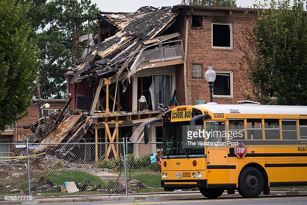 Montgomery county maryland fire stock photos and pictures getty images children walk by the remains of the flower branch apartments fire that killed 7 and left about 100 homeless last month in silver spring md mightylinksfo
