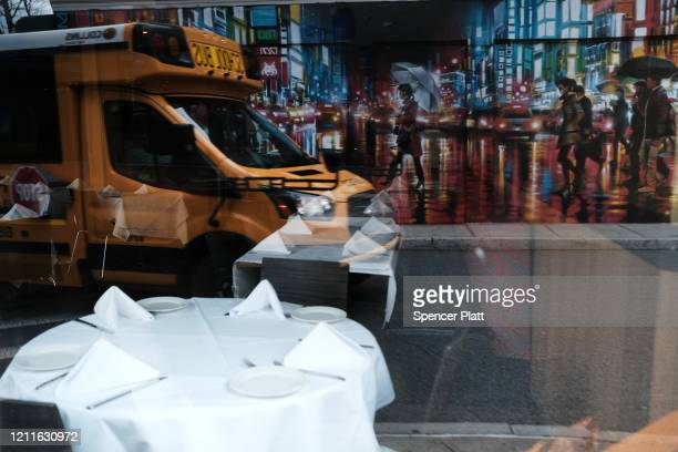 A bus drives down a street downtown on March 10 2020 in New Rochelle New York New Rochelle a city just north of New York City has become the state's...