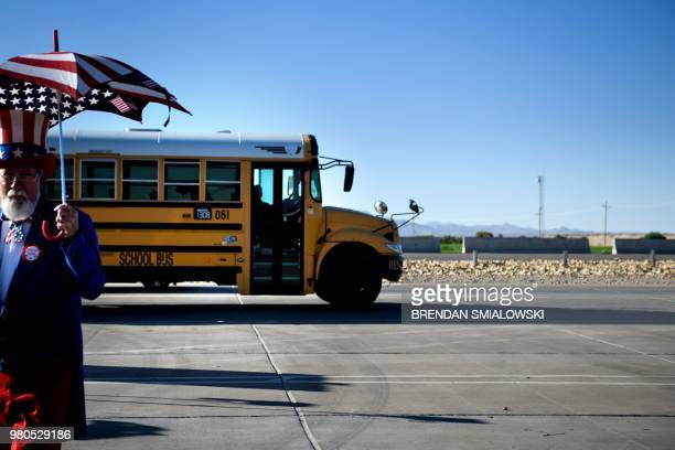 Bus drives into the Tornillo Port of Entry where minors crossing the boarder without the proper papers have been housed after being separated from...