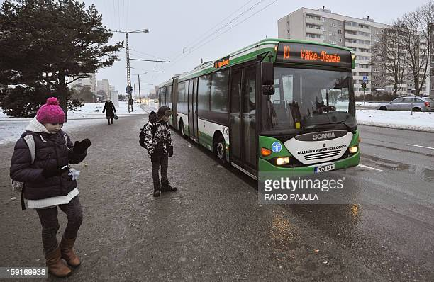 A bus drives on a street in Tallinn on January 9 2013 From January 1 residents of the Estonian capital can use public transports in Tallinn for free...