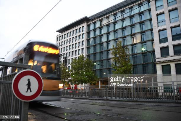 A bus drives past the Belgium's federal court building where Catalonia's deposed leader Carles Puigdemont is due to appear after a Spanish judge...