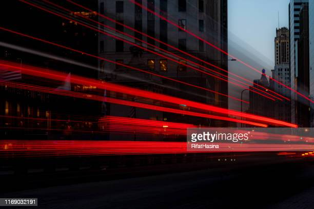 bus driving along michigan avenue, chicago, illinois, united states - light trail stock pictures, royalty-free photos & images
